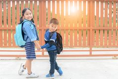 Sister and brother ready go to school, stock photos