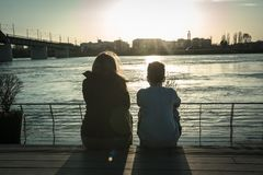 Sister and brother by the river stock image