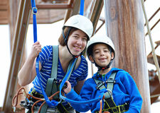 Sister and brother on the roap course sky trail Stock Image