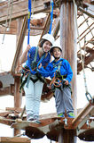 Sister and brother on the roap course sky trail Royalty Free Stock Photo
