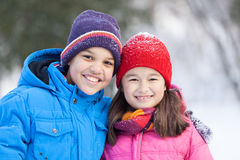 Sister and brother smiling and hugging outside. Royalty Free Stock Images