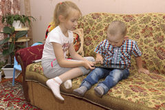 Sister and brother with tablet Royalty Free Stock Image