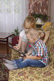 Sister and brother with tablet Stock Images