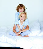 Sister and brother together in bed Royalty Free Stock Photography