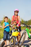 Sister and  brothers with bicycles Royalty Free Stock Photography