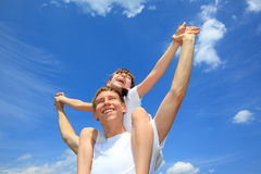 Sister on brothers shoulders Royalty Free Stock Photos