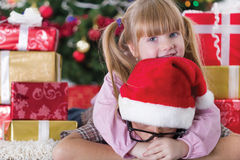 Sister embrace boy on Christmas evening Stock Photos