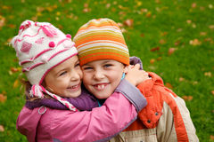 Sister, embraces her brother Royalty Free Stock Images