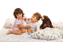 Sister embracing little brother Stock Photos