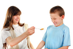 Sister feed a Little Brother Stock Image