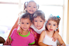 Sister and friends kid girls in hug happy together. Posing looking camera stock photo