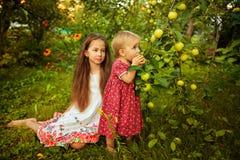 Sister in the garden Royalty Free Stock Photos
