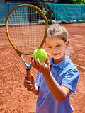 Sister girl athlete  with racket and ball Royalty Free Stock Image