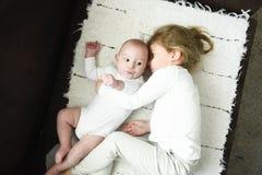 Sister girl hugs newborn brother royalty free stock photo