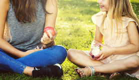 Sister Girls Talk Picnic Togetherness Outdoors Concept Royalty Free Stock Image