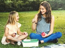 Sister Girls Talk Picnic Togetherness Outdoors Concept Stock Photography