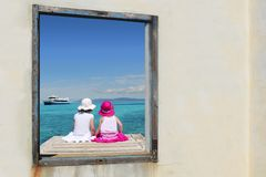 Sister girls view window tropical sea turquoise Royalty Free Stock Image