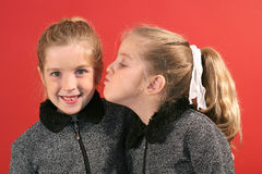 Sister giving a kiss Royalty Free Stock Image