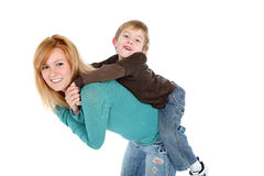 Sister giving a piggy back ride Royalty Free Stock Photo