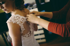 Sister helping bride prepare Stock Image