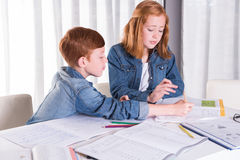 Sister is helping brother with homework Royalty Free Stock Photography