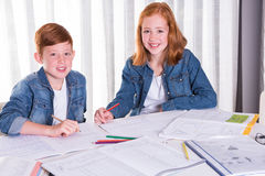 Sister is helping brother with homework Royalty Free Stock Images