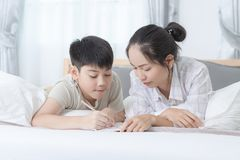Sister helping brother to writing homework Royalty Free Stock Image