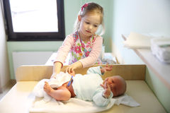 Sister with her newborn brother Royalty Free Stock Photo