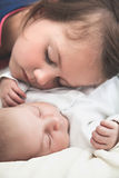 Sister and her newborn brother sleeping Royalty Free Stock Photography