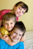 A sister with her two brothers. A sister hanging out with her two brothers at home Royalty Free Stock Photos