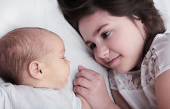 Sister Holding Hand of Newborn Baby Brother royalty free stock photos