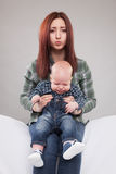 Sister holding her crying baby brother Royalty Free Stock Photo