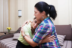 Sister hugging and comforting. Older sister hugging and comforting her younger sister Royalty Free Stock Images