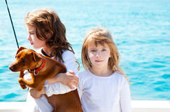 Sister kid girls with dog on the sea Stock Photography