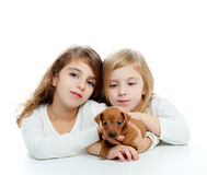 Sister kid girls and puppy mascot mini pinscher Stock Photo