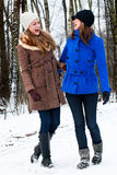 Sister laughing on a winter white road Stock Photo