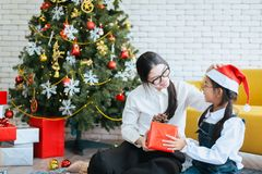 Sister make a christmas gift box to younger sister,Happy and smiling. Together stock photography