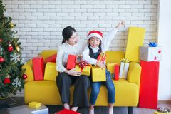 Sister make a christmas gift box to younger sister,Happy and smiling. Together stock photos