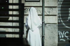 The sister of mercy. Snow-white apparel of the sister of mercy in the urban landscape Stock Images
