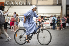 Sister nun cycling in the cities. On bicycle Royalty Free Stock Photos