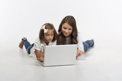 Sister play on computer Stock Image