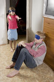 Sister plays with her brother. Stock Photography