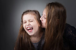 Sister portraits, studio Stock Photography