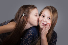 Sister portraits, studio Stock Images