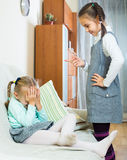 Sister preaching little one. Annoying big sister preaching little one and shaking finger Royalty Free Stock Photo