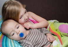Sister pull ear of her brother. Stock Images