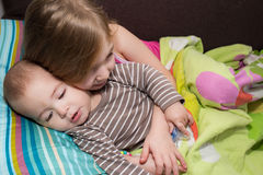 Sister pull ear of her brother. Royalty Free Stock Images
