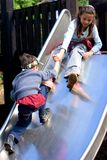 Sister pulls brother up Stock Photography