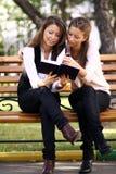 Sister Readink Book Stock Photos