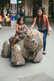 Sister`s bonding in Luna park riding a toy car.  Royalty Free Stock Photography